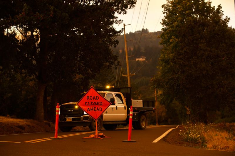 PMG PHOTO: JAIME VALDEZ - Chehalem Road remained closed  at mid-day Wednesday, Sept. 9. The road leads to Bald Peak.