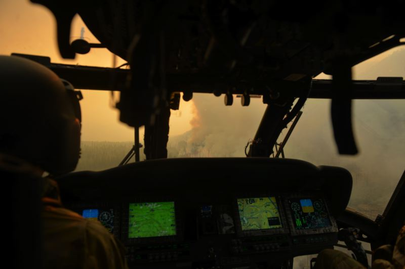 COURTESY PHOTO: OREGON NATIONAL GUARD.  - A helicopter crew with the Oregon National Guard prepares to help battle a wildfire from the air.