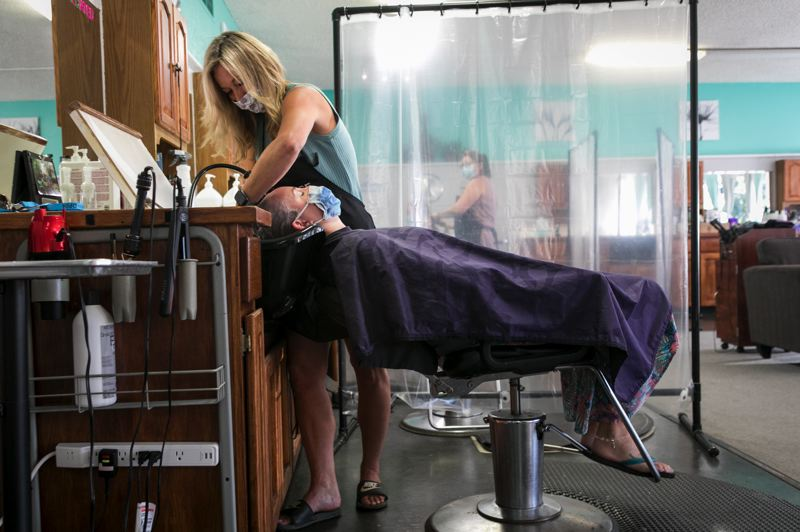 PMG PHOTO: JAIME VALDEZ - Business is steady at the Absolute Hair Boutique, but owner Mindy Neirheim, said she doesn't know if she'll be able to reopen again if Washington County shuts down again.