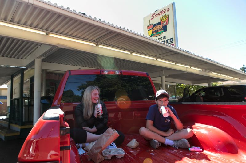 PMG PHOTO: JAIME VALDEZ - Emma Gray, left, takes Chase Disney to Scottie's Drive-In for the first time on Thursday, Aug. 27, 2020.