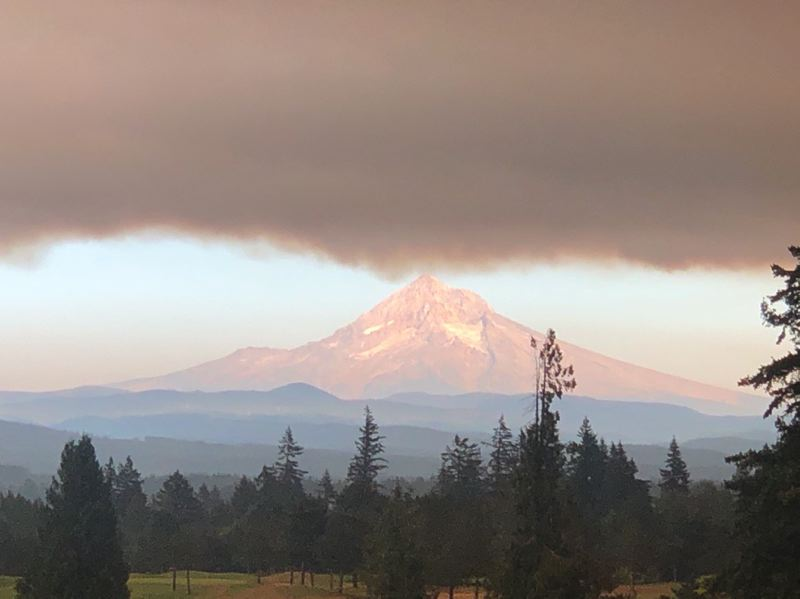 PMG PHOTO: MARK GARBER - An ominous roof of smoke, the color of old bruises, hovers over Mount Hood on Wednesday afternoon. The National Weather Service says the smoke likely will cling to the area through Thursday and into Friday.