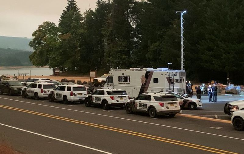 COURTESY PHOTO: WASHINGTON COUNTY SHERIFF'S OFFICE - Washington County Sheriff's Office vehicles and other emergency responders stage at Scoggins Valley Park, home of Henry Hagg Lake, during firefighting efforts against the Powerline Fire to the south.
