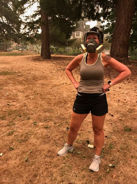 COURTESY PHOTO: HEIDI MCKAY - Oregon City resident Amanda Alwine said she's still happy to be able to go for her daily run Thursday morning, using her COVID-19 face mask that also works for wildfire smoke.