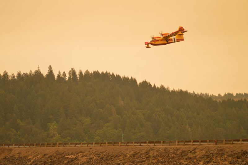 COURTESY PHOTO: FOREST GROVE FIRE & RESCUE - A Super Scooper firefighting aircraft swoops over Henry Hagg Lake to fill up on water as it provides air support against wildfires burning in Washington and Yamhill counties Thursday, Sept. 10.