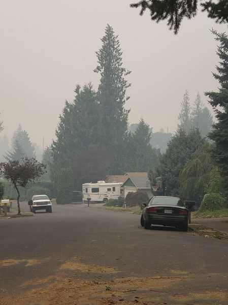PMG PHOTO: STEVE BROWN - Thick smoke has permeated the air in Sandy as the city limits move into level two evacuation.
