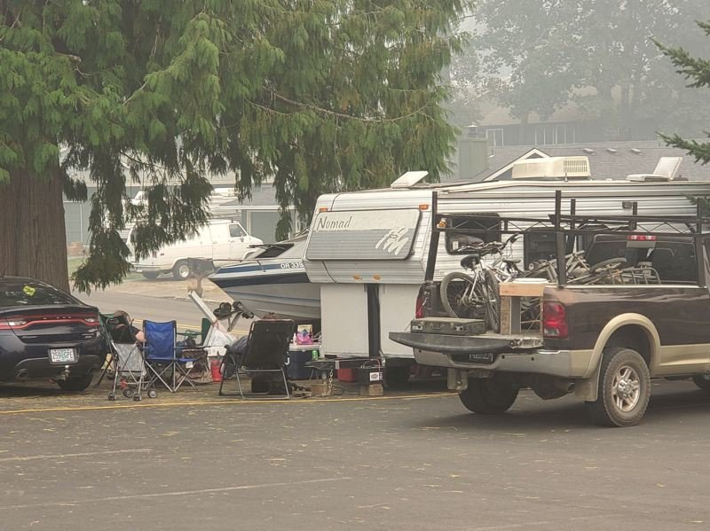 PMG PHOTO: STEVE BROWN.  - Evacuees have set up in the Sandy Assembly of God church parking lot on McCormack Street in Sandy. Many similar camps have sprung up all over town.