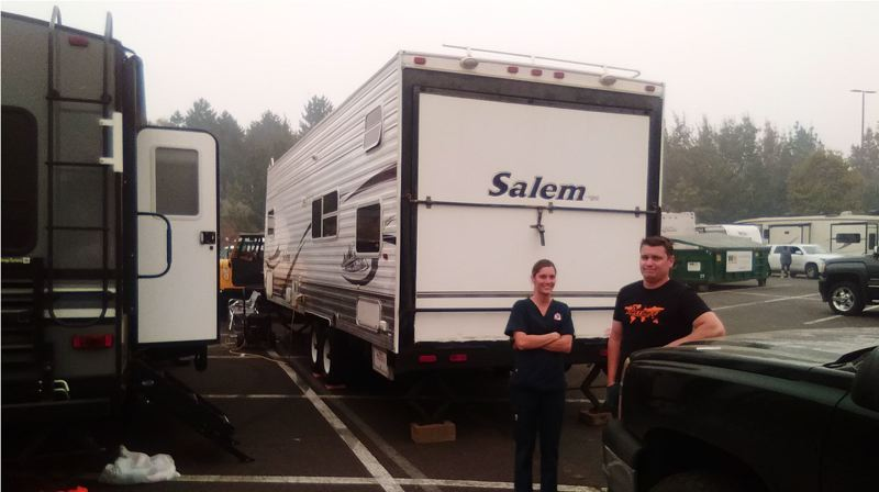 PMG PHOTO: RAYMOND RENDLEMAN - Estacada resident Chris Boudreau escaped Tuesday night to stay with friend and Beavercreek resident Kelly Schmidt who was then evacuated herself on Thursday. They've parked their RVs in the same area of the Clackamas Town Center.