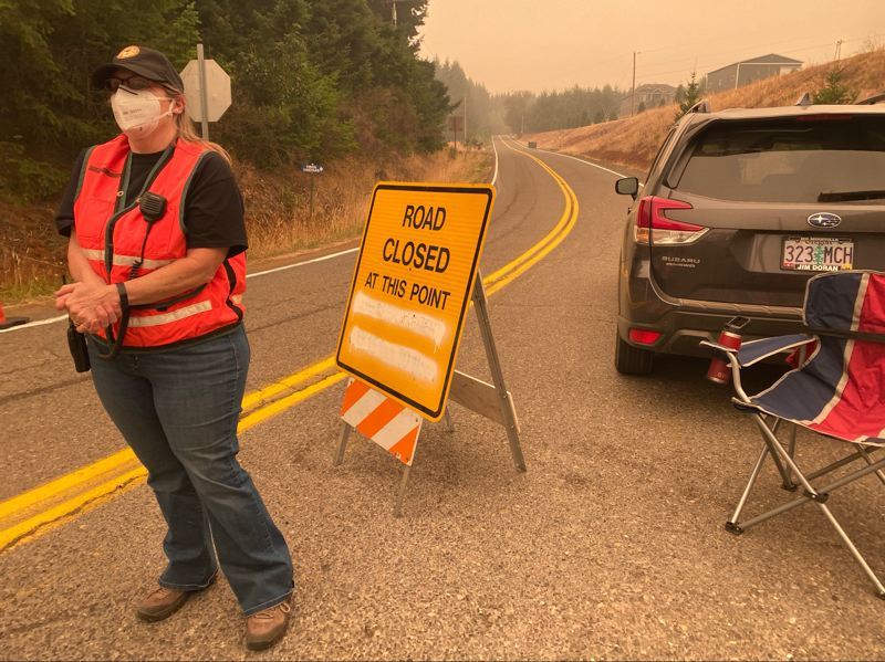 PMG PHOTO: ALVARO FONTAN - Roads into the evacuation area remained blocked off Thursday, Sept. 10, as firefighters worked to get a handle on the Chehalem Mountain-Bald Peak Fire.