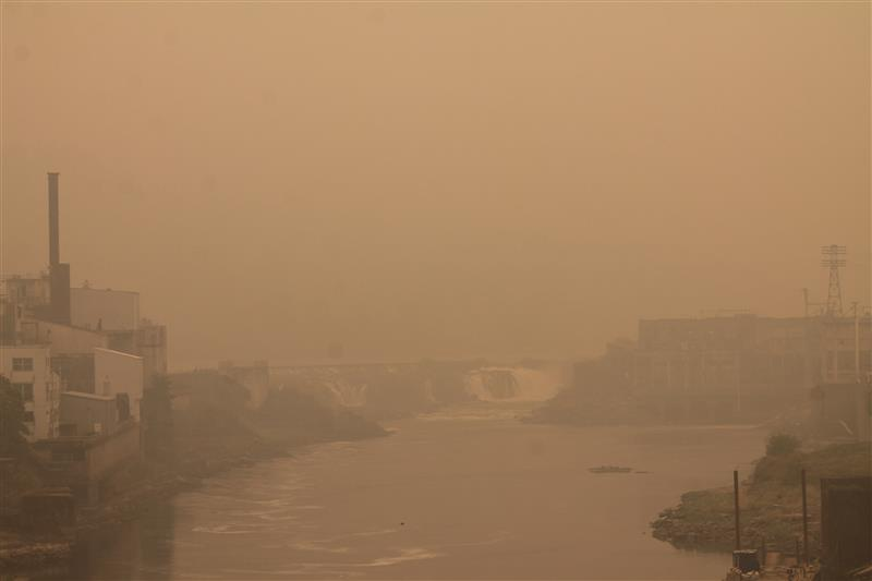 PMG PHOTO: HOLLY BARTHOLOMEW - Willamette Falls is barely visible from the Arch Bridge because of thick smoke in the area.
