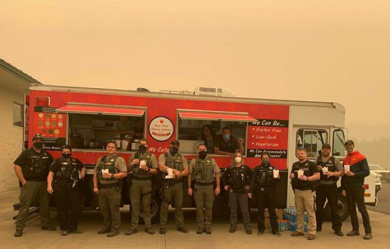 COURTESY PHOTO: DENNIS GORTON - Law enforcement stationed in Estacada on Saturday get a free meal courtesy of the Chop Chop Chicken Sundaes food truck.