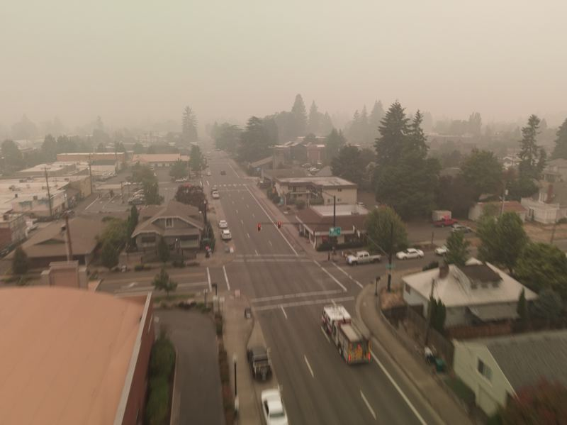 PMG PHOTO: ALVARO FONTAN - Thick smoke hovers over the town of Newberg. Cooler weather has arrived and rain is expected but the smoke likely will remain well into the week.