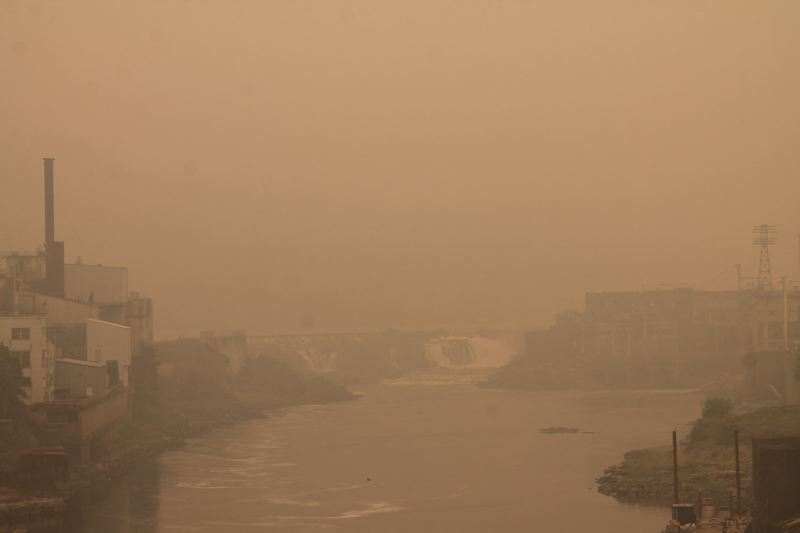 PMG PHOTO: HOLLY BARTHOLOMEW - Willamette Falls is barely visible from the Arch Bridge because of thick smoke in the area Friday, Sept. 11.
