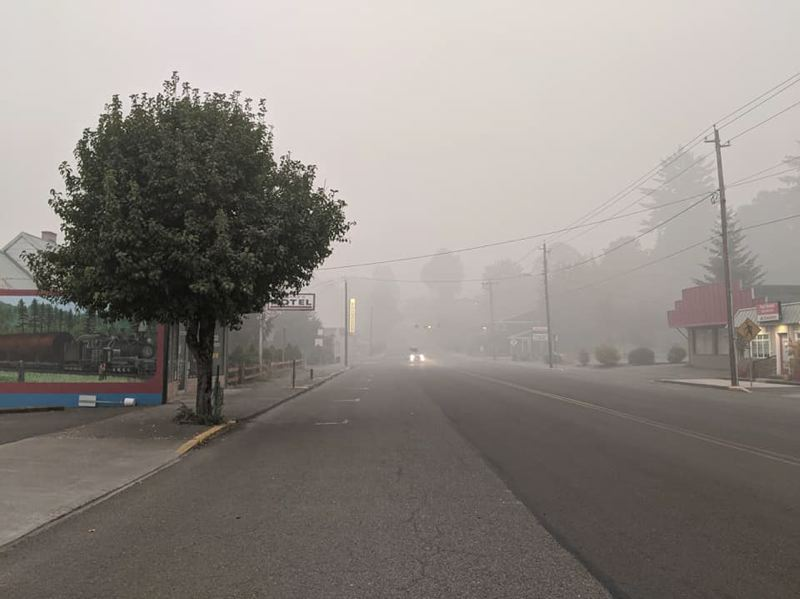 PMG PHOTO: EMILY LINDSTRAND - Main Street in downtown Estacada was covered in smoke on Saturday, Sept. 12.
