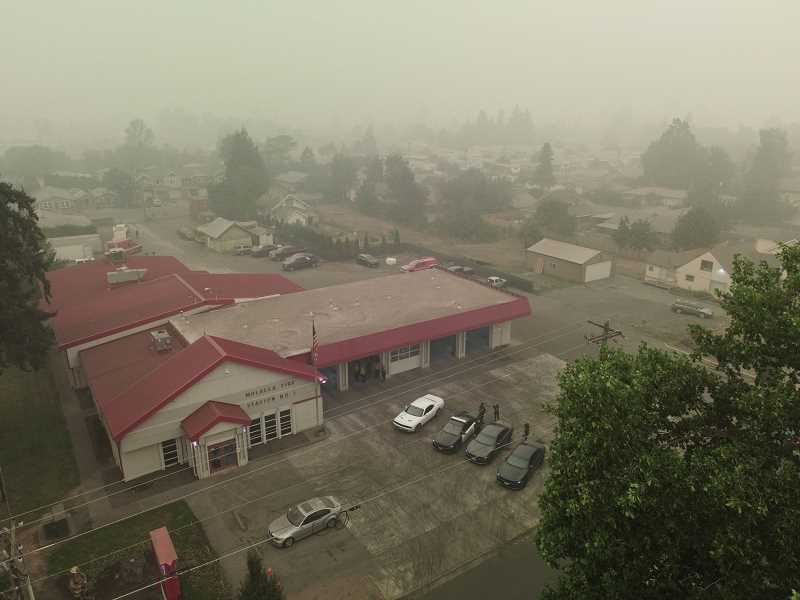 PMG PHOTO: ALVARO FONTAN - The Molalla Fire station is visible through the smoke in Molalla on the afternoon of Thursday, Sept. 10. Sunday evening, many evacuation orders were downgraded to allow residents to return home.
