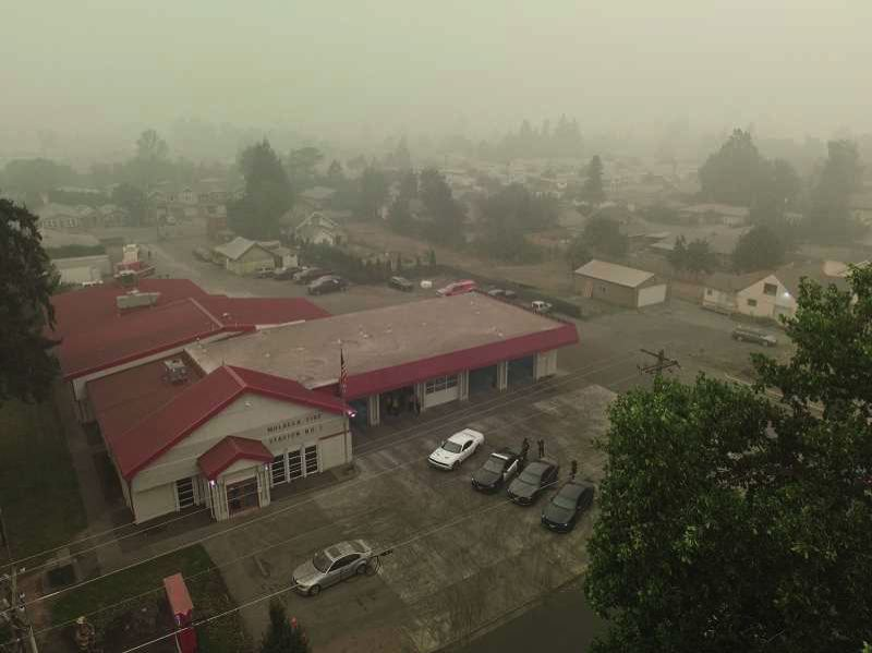 PMG PHOTO: ALVARO FONTAN - The Molalla Fire Station is visible through the smoke late last week. On Sunday evening, many evacuation orders were downgraded to allow residents to return home.
