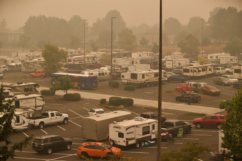 PMG PHOTO: JAIME VALDEZ - Evacuees of the wildfires ravaging Clackamas County camp out in the parking lots that surround Clackamas Town Center mall.