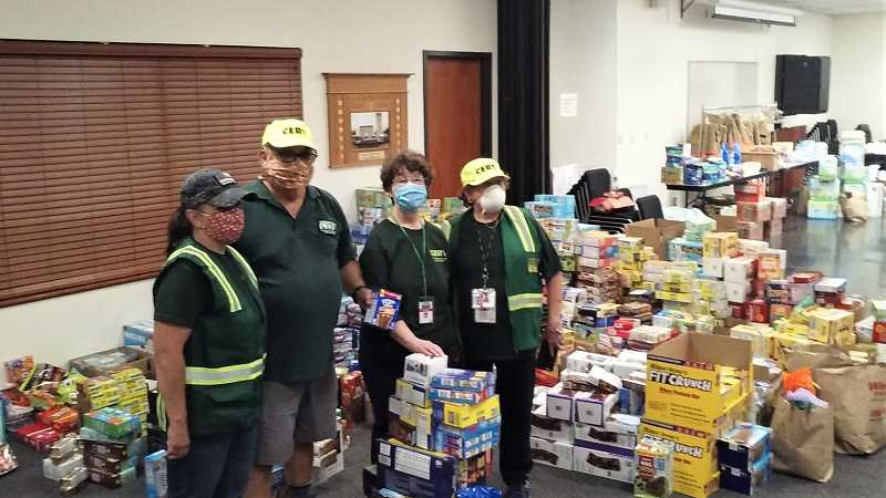 COURTESY PHOTO: JACK TANZ - Milwaukie Community Emergency Response Team members drop off donations to Clackamas Fire on Sept. 10.