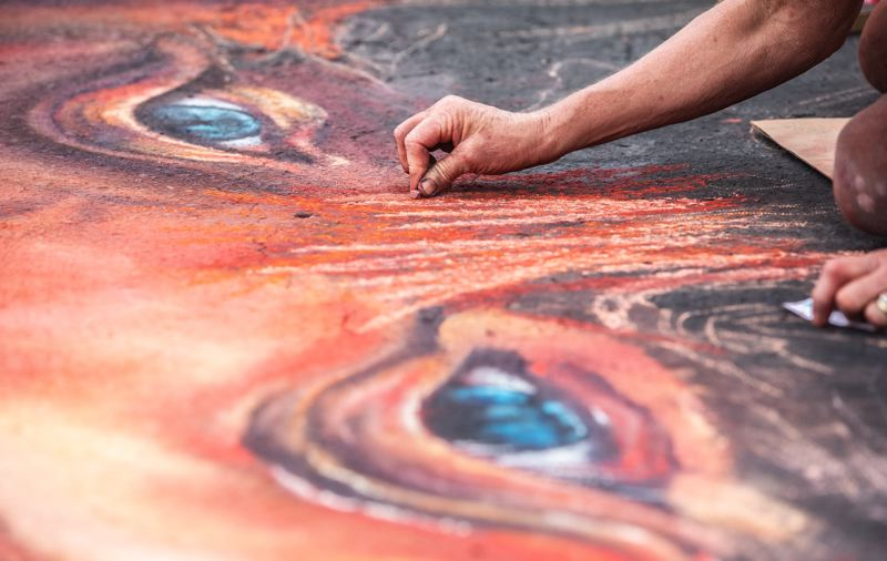 PMG FILE PHOTO - Cynthia Kostylo works on her chalk art work during La Strada dei Pastelli in Beaverton last August.