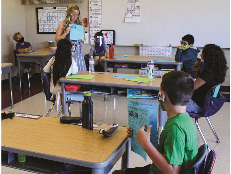 JASON CHANEY - Kerry Lysne's third grade class at Barnes Butte Elementary participates in a lesson last Tuesday.
