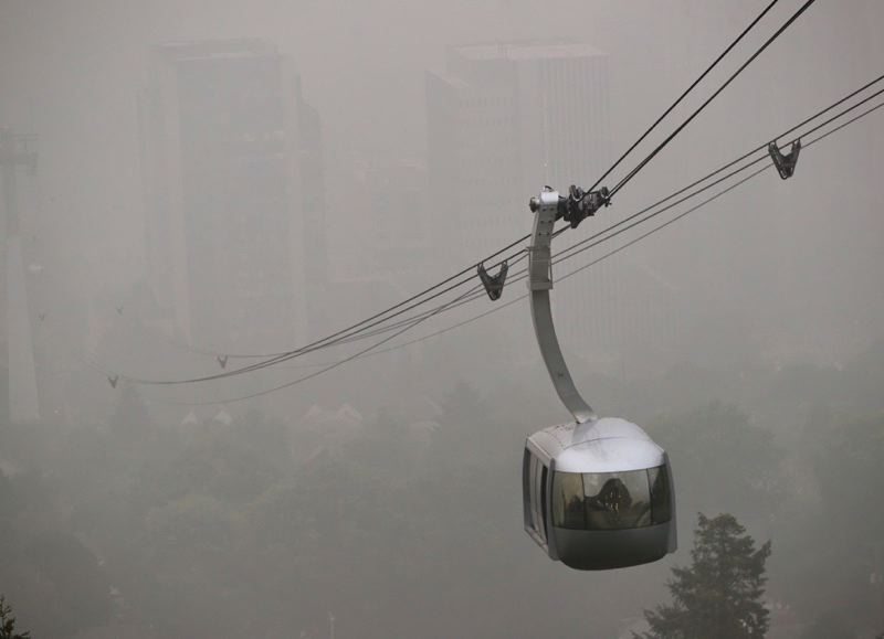 PMG PHOTO: JAIME VALDEZ - The Oregon Health & Science University tram, floating in from out of the thick smoke that hovers over the region, early Tuesday, Sept. 15.