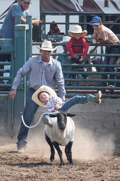 LON AUSTIN - Jasper Hartman can feel his ride slipping away during the sheep riding competition.