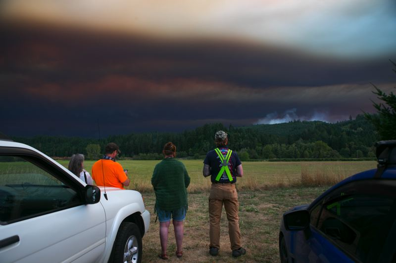 PMG PHOTO: JAIME VALDEZ - Observers keep watch over the Powerline Fire. Wildfires will be part of the Northwest for the foreseeable future, but good policy — public and private — can do much to help.