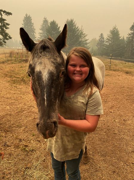 COURTESY PHOTO - Piper Coy is all smiles with her horse, Pepper. The Estacada sixth grader created a video for firefighters and evacuees of the Riverside Fire.