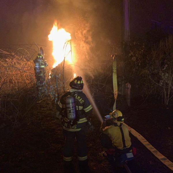 COURTESY PHOTO - Firefighters work to extinguish a blaze in Clackamas County.
