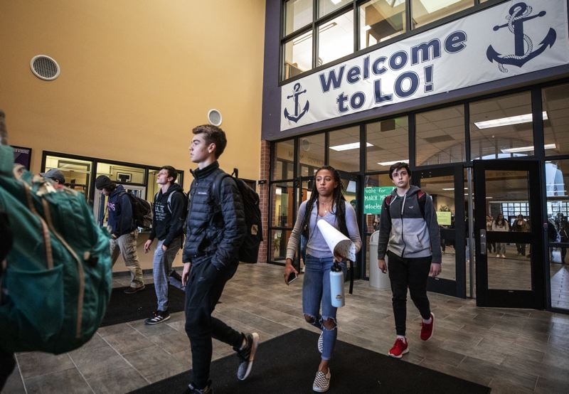 PMG FILE PHOTO - Lake Oswego High students exit school on Friday amidst uncertainty when they would reutrn due to the COVID-19 outbreak on Feb. 3, 2020.