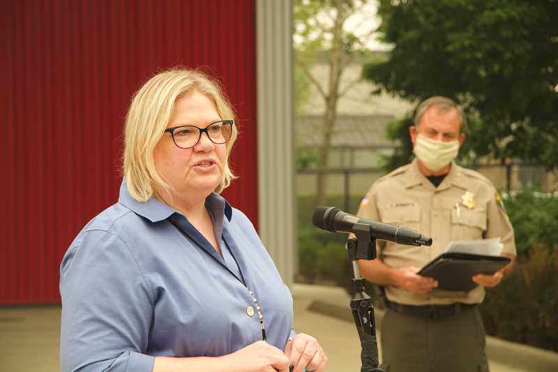 PMG PHOTO: SAM STITES - At a recent press conference, Clackamas County Incident Commander Nancy Bush tells citizens that the weather was bringing hope for fighting wildfires.