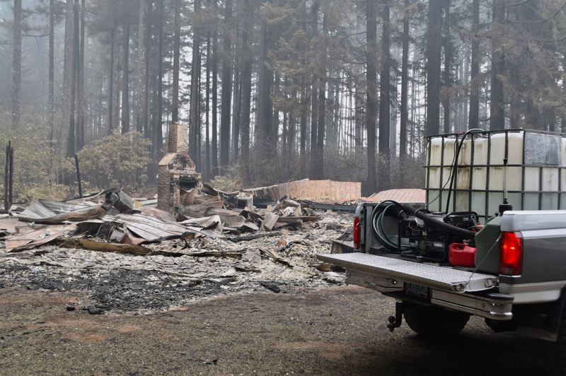 PMG PHOTO: BRITTANY ALLEN - Several crews, like Rolens, have been patrolling the Estacada area equipped with large plastic totes of water, generators and hoses in the past few weeks to watch for spot fires.
