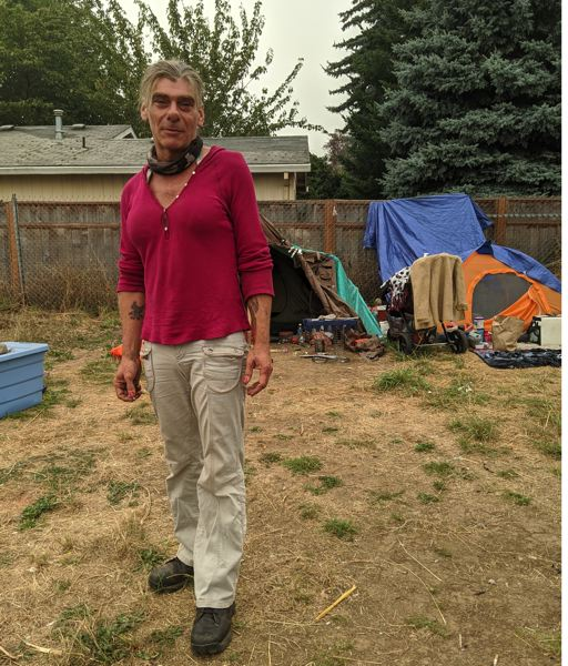 PMG: JOSEPH GALLIVAN  - Aelita Walker, who lives in a tent on a patch of grass where Southeast Washington Street crosses the I-205, says the wildfire smoke has been bad for her breathing, worse than her usual complications from smoking cigarettes.