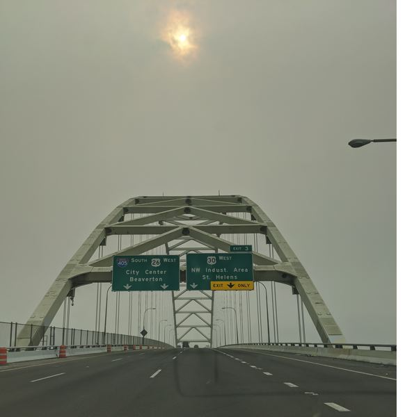 PMG: JOSEPH GALLIVAN - Wild fire smoke over Portland's Fremont Bridge from Sept. 11 to Sept 18, 2020, affected people with preexisting respiratory cnditions. But how did the homeless cope, being out in it 24/7?