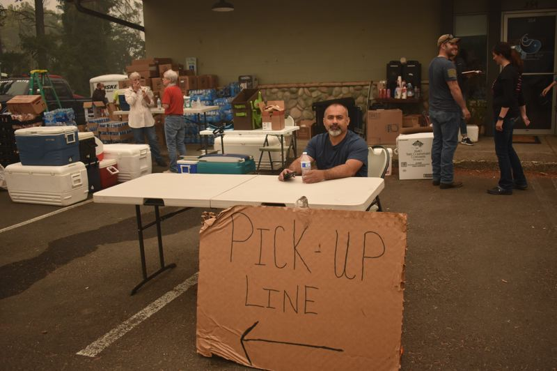 PMG PHOTO: EMILY LINDSTRAND - Carlos Martinez volunteers at the relief center coordinated by Estacada Community Watch.
