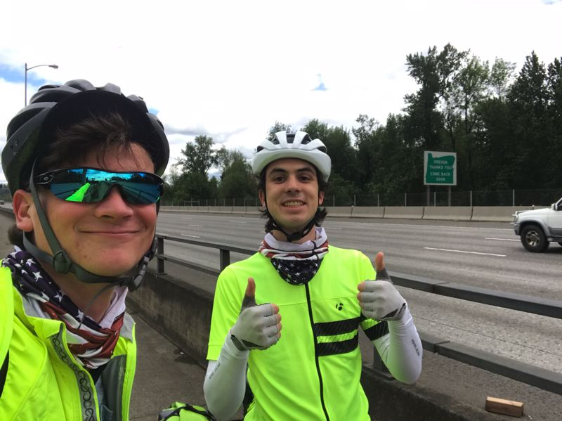 COURTESY PHOTO: PHILIP LADUCA - LaDuca and his cousin Jonah take a photo on the I-205 bridge into Washington after crossing the first state off their journey in June.