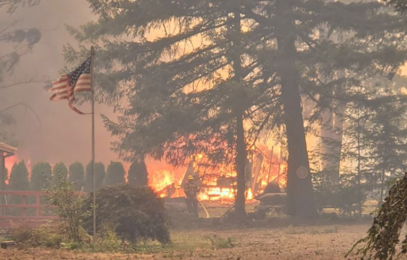 COURTESY PHOTO - Flames rage on as crews work to contain the Riverside Fire in Clackamas County.