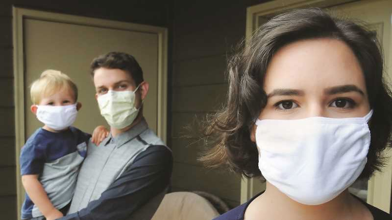 The Oregon Health Authority is continuing to advise people to wear masks and practice social distancing to slow the spead of COVID-19.