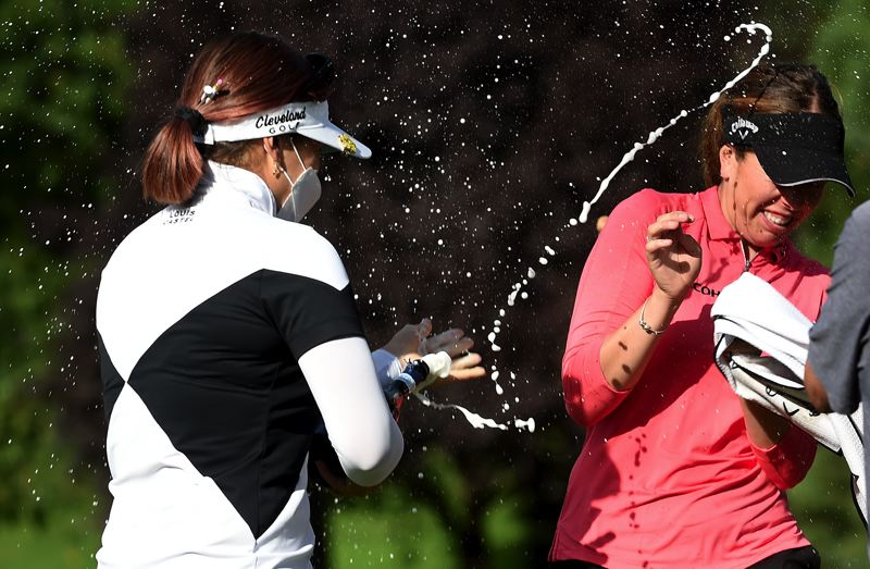COURTESY PHOTO: STEVE DYKES/GETTY IMAGES - Hannah Green, the 2019 champ, sprays champagne over Georgia Hall of England after she won the the Cambia Portland Classic on the second playoff hole at Columbia Edgewater Country Club on Sunday.