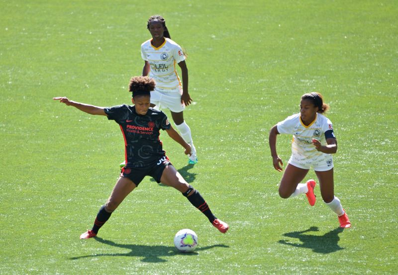 COURTESY PHOTO: CRAIG MITCHELLDYER/PORTLAND THORNS FC - Simone Charley controls the ball Sunday afternoon in the Portland Thorns 3-0 win over Utah Royals FC. Charley scored the first goal of the game.