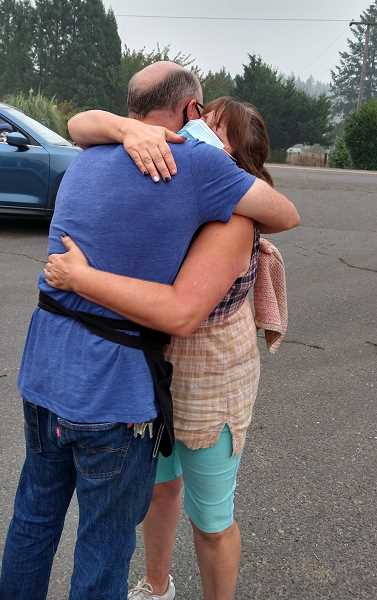 COURTESY PHOTO: ARLENE ANDERSON - One thankful resident receives a hug as Arlene's Cuisine hands out free food in Colton Thursday, Sept. 17.