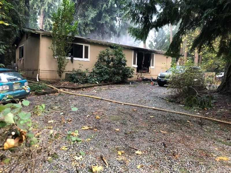 COURTESY PHOTO: MOLALLA FIRE - A home just outside Molalla burned early morning Sunday, Sept. 20 and is a total loss.