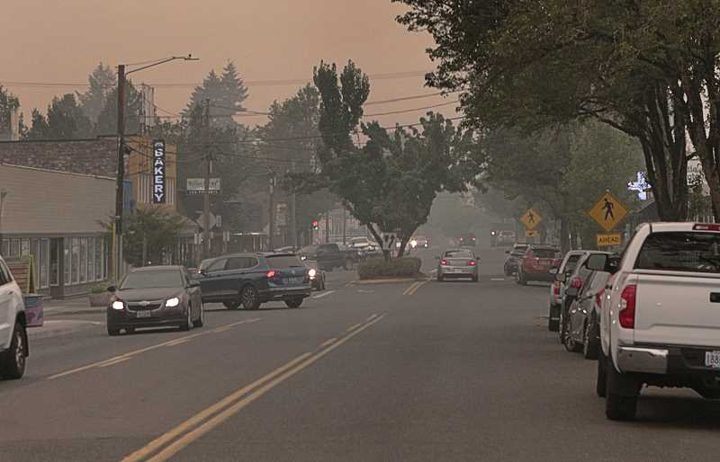 DAVID F. ASHTON - When the 50-mph winds wound down, it wasnt long until smoke rolled into Southeast Portland - Woodstock Boulevard Business District is shown here - and lingered.