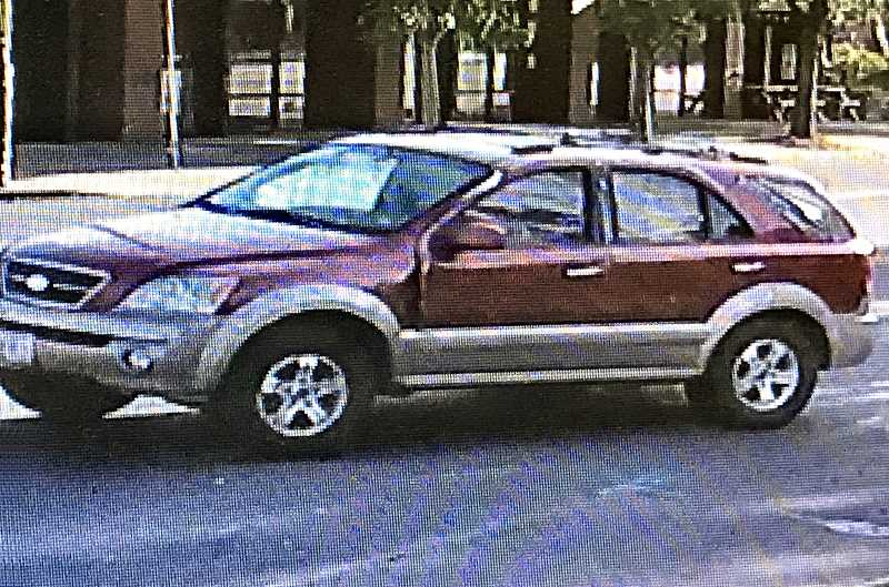 SURVEILLANCE IMAGE - This still image from a video surveillance recording shows a Subaru Forester getting up ramming speed on S.E. Woodstock Boulevard, before smashing into the entrance of the Woodstock U.S. Bank branch. The driver is now wanted for felony hit and run.