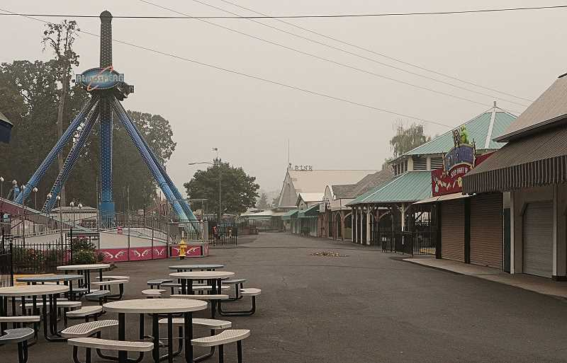 DAVID F. ASHTON - Cloaked in dense wildfire smoke in mid-September, the Oaks Amusement Park midway looked desolate, without families there to enjoy it.