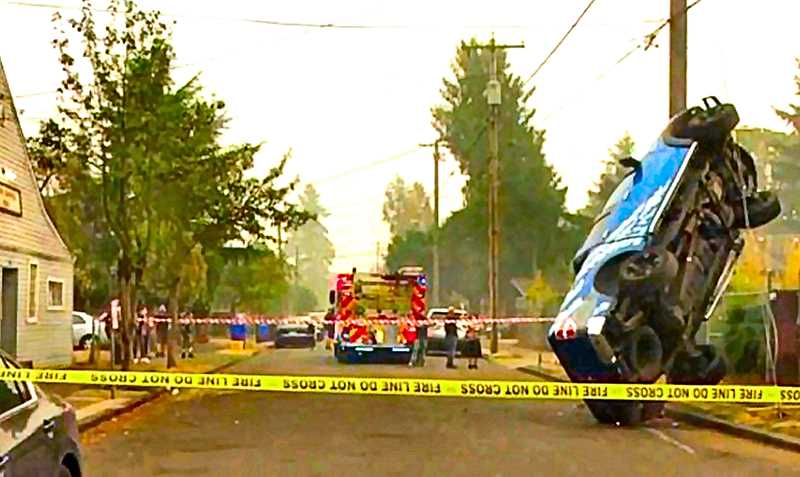 COURTESY OF KATU-TV-2 - The driver of this truck, on S.E. 65th, faces DUII and other charges after this unusual crash on the smoky day of September 16th.