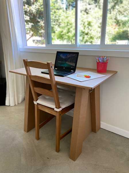 COURTESY PHOTO - A cardboard desk designed by the Parent Teacher Club of McKay Elementary School in Beaverton. The club has a fund to create the desks for students.