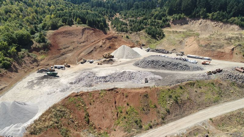 PMG PHOTO: ALVARO FONTAN - An aerial photo shows an excavation area and mounds solid waste stored at Westside Rock Hayden Quarry.