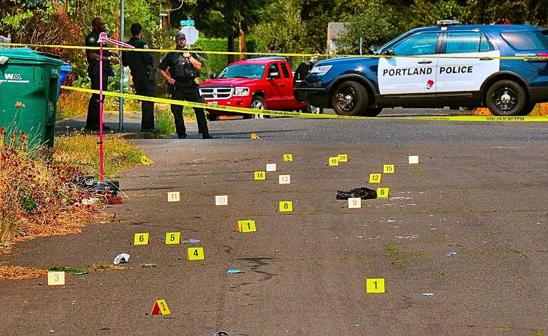 DAVID F. ASHTON - In the Lents Neighborhood, S.E. 99th Avenue was littered with bullet casings after the September 7th shooting incident - each casing was pinpointed with a yellow evidence marker.