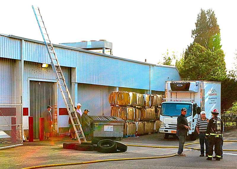 DAVID F. ASHTON - With what appeared to be smoldering tires removed from the building, a PF&R investigator spoke with officials from the Brooklyn-based Columbia Empire Meat Company.