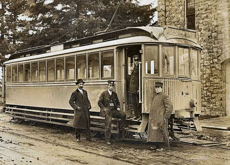 COURTESY DANA BECK COLLECTION - The Eastside Railway was built along 13th Avenue in Sellwood in 1893, where few  homes and business were yet established. Here, three motormen of the Sellwood Branch Streetcar are shown taking a break. While only 800 people lived in Sellwood in 1890, three years later - because of the arrival of the streetcar - the population had ballooned to 1,800. (The PGE Power Station in the background is still there!)
